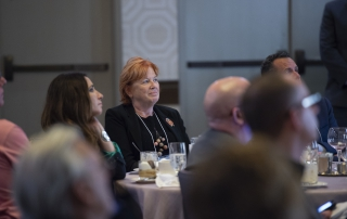 Former Pitt Provost and Senior Vice Chancellor Patricia Beeson listens at the AAS welcome reception at the Fairmont Pittsburgh on October 11, 2018.