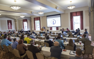 Attendees observe a panel presentation at the 2018 Advanced Analytics Summit at the University of Pittsburgh University Club on October 12, 2018.