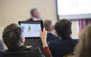 An attendee photographs a helpful presentation slide at the 2018 Advanced Analytics Summit at the University of Pittsburgh University Club on October 12, 2018.